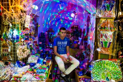 Salesman in a toy store. Market in the old town. Jerusalem.